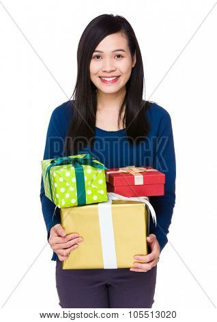 Young woman hold with many gift box