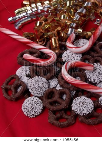 Candy Canes, Nonpareils & Chocolate Pretzels On Red