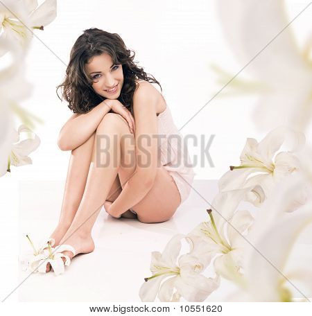 legs of beautiful girl with lily