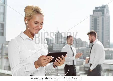 Attractive businesswoman using tablet outdoor