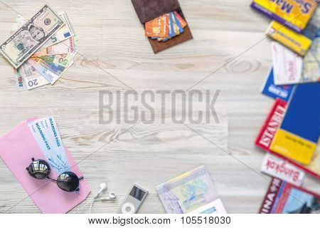 Desk of mature voyager Travel background with essential tourist items on wooden desk