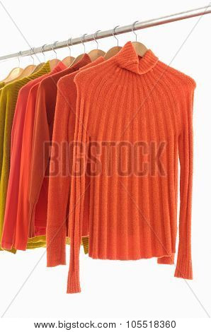 female yellow and orange clothing on display