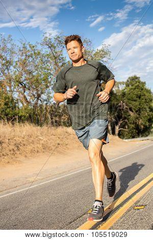 Man running down the center of a rural street