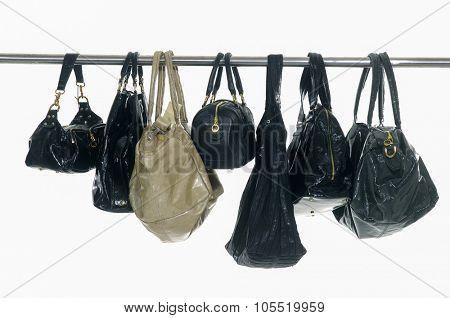 Set of different bag for females on hangers