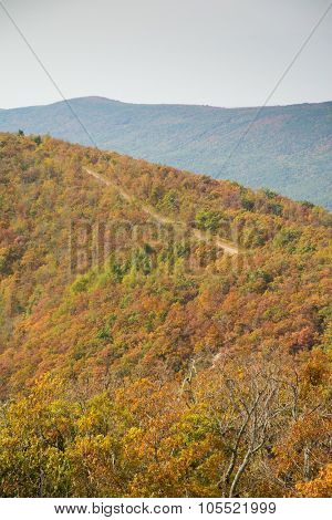 Talimena scenic byway running on the crest of the mountain, with trees in fall colors