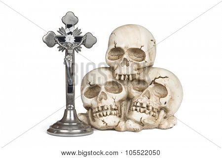 Crucifix and weathered human skull isolated over white with clipping path.