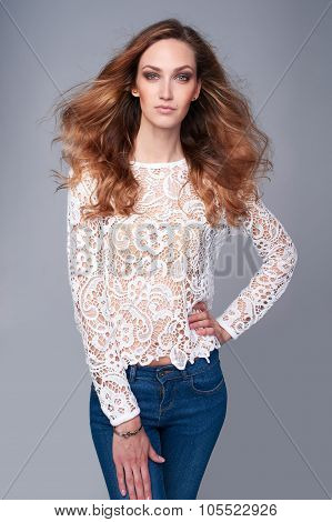Half length portrait of fashion model in lace top