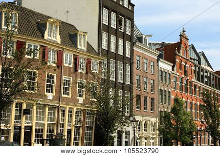 The Historic Houses In The Old Town Of Amsterdam (the Netherlands).