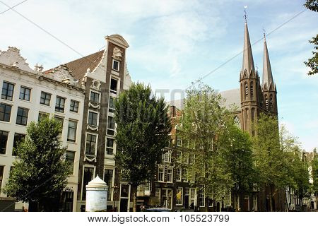 The Historic Church And Houses In The Old Town Of Amsterdam (the Netherlands).