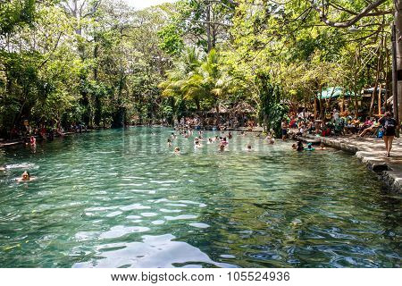 Ojo De Agua, Ometepe Island, Nicaragua- March 31 2015: People Swimming In Water