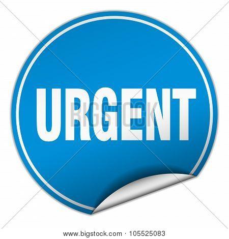 Urgent Round Blue Sticker Isolated On White