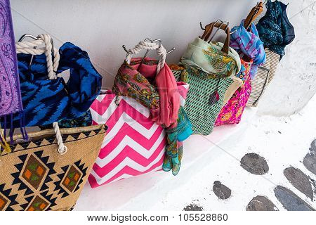 Brightly colored bags shopping in Mykonos