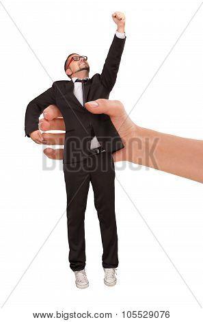 Woman's hand holding businessman