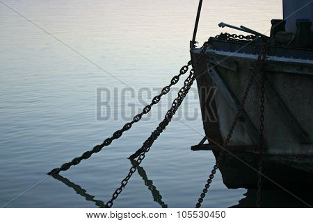 Anchor chains hanging from boat