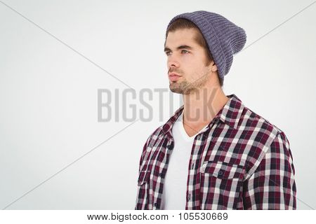 Confident man looking away against white background
