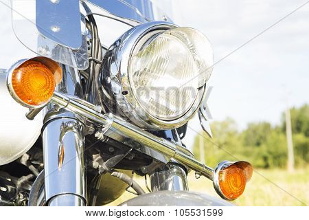 Motorcycle Headlight Close-up Outdoor.