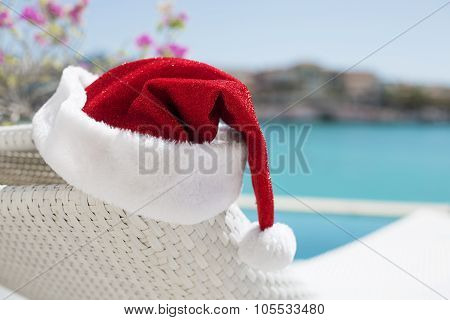 Red Christmas hat by the pool
