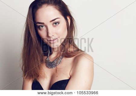 Beautiful Young Woman With Dark Hair And Natural Makeup
