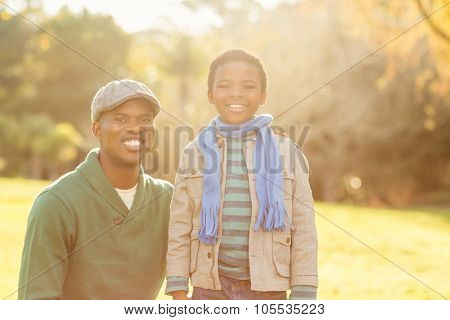 Portrait of a father with his son on an autumns day