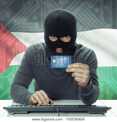 Dark-skinned Hacker With Flag On Background Holding Credit Card - Palestine