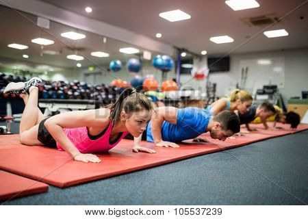 Fit people working out in fitness class at the gym