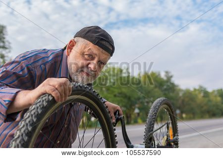 portrait of senior bicycle mechanic at work