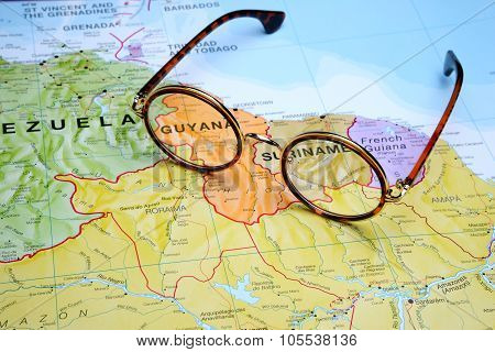 Glasses on a map - Guyana
