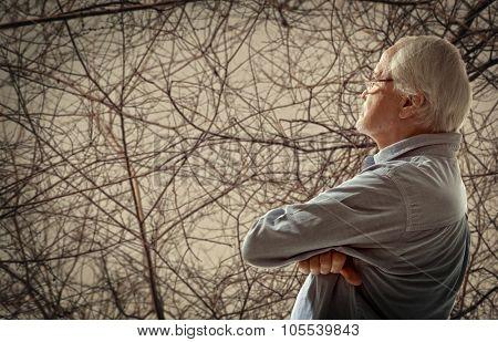 Autumn. Portrait of a senior man thinking about something