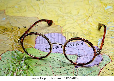 Glasses on a map - Asuncion