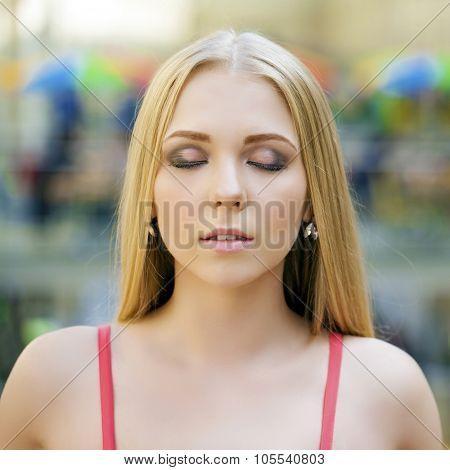 Portrait of attractive blonde girl, makeup female face indoor