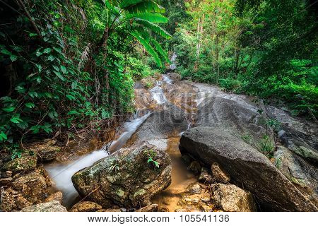 Tropical Rain Forest Landscape With Small Waterfall. Thailand