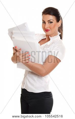 Portrait of a confident young woman standing  with documents