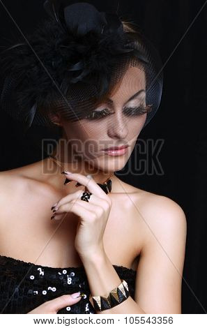 Retro-stylized woman in black hat with veil