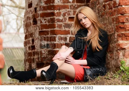 Sexy Lady Leaning against an Stone Wall