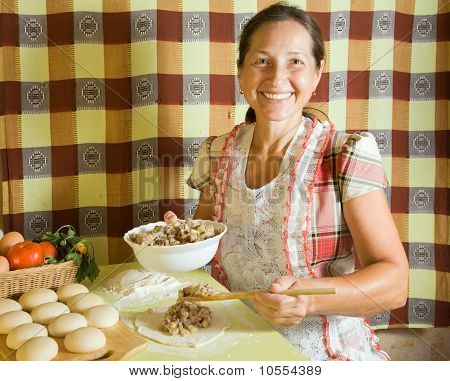 Woman Cooking Meat Pasty