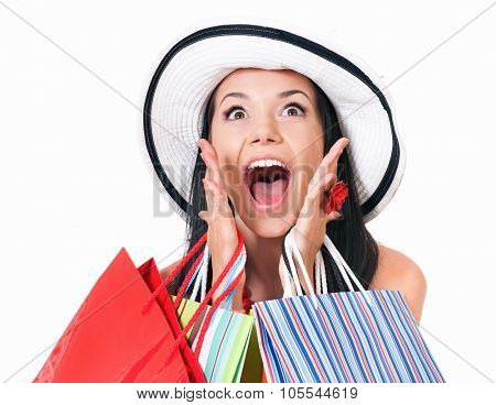 Portrait of young shopaholic woman with many shopping bags, isolated on white background