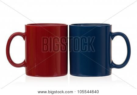 Two cups for coffee or tea - red and blue, isolated on white background