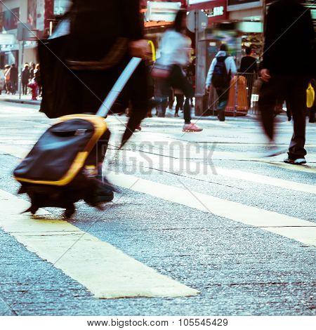 Pedestrian With Travel Bag Walking At City Street. Hong Kong
