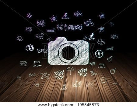 Tourism concept: Photo Camera in grunge dark room