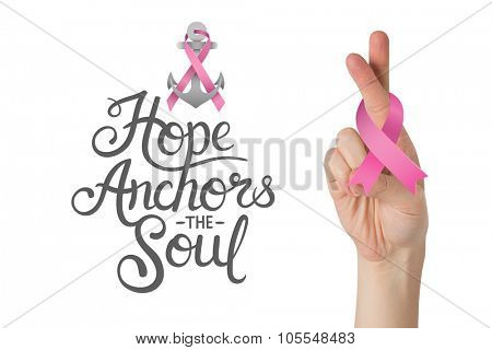 Crossed fingers with breast cancer ribbon against breast cancer awareness message
