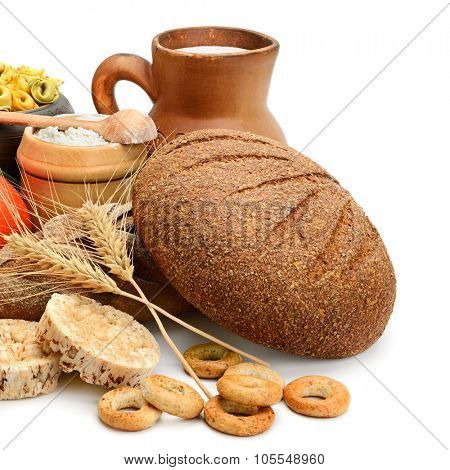 Composition of bread, milk, vegetables isolated on white