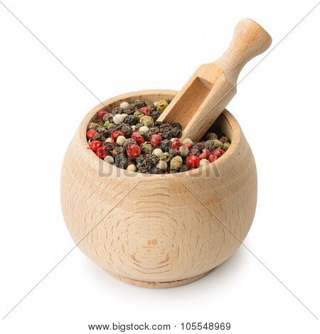 grains pepper and wooden scoop in pot isolated on white