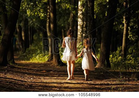 Little Girls Walking In The Sunny Forest