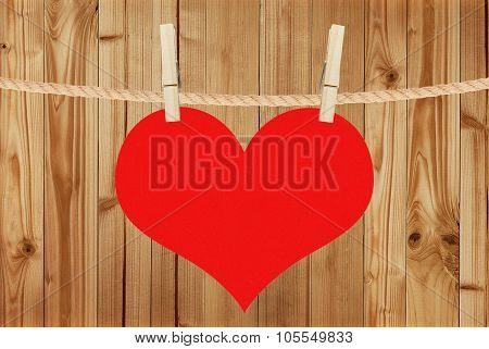 Red Heart Hang On Clothespins Over Wooden Background