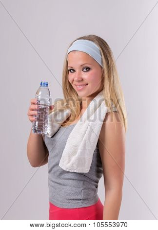 Beautiful Girl After Fitness With A Water Bottle. With A Towel And A Smile.
