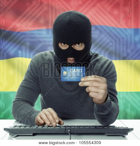 Dark-skinned Hacker With Flag On Background Holding Credit Card - Mauritius