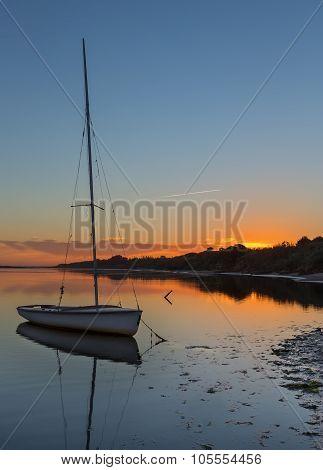 Beautiful Sunset At Sea With Yacht On The Water. Romantic Landscape.