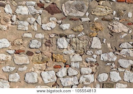 Ancient Stone Wall. As Texture And Background.