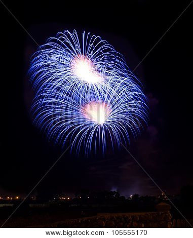 Blue, violet with red colorful fireworks in black background,artistic fireworks in Malta