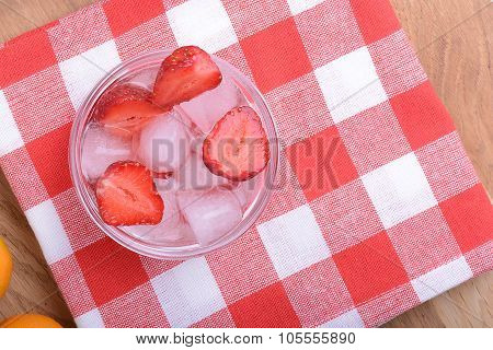 A Slice Of Red Strawberry On Glass Plate In Party Theme Background